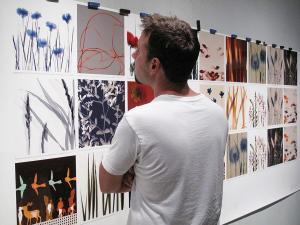 Artist Ethan Jantzer inspecting print color prior to the renowned Cherry Creek Arts Festival