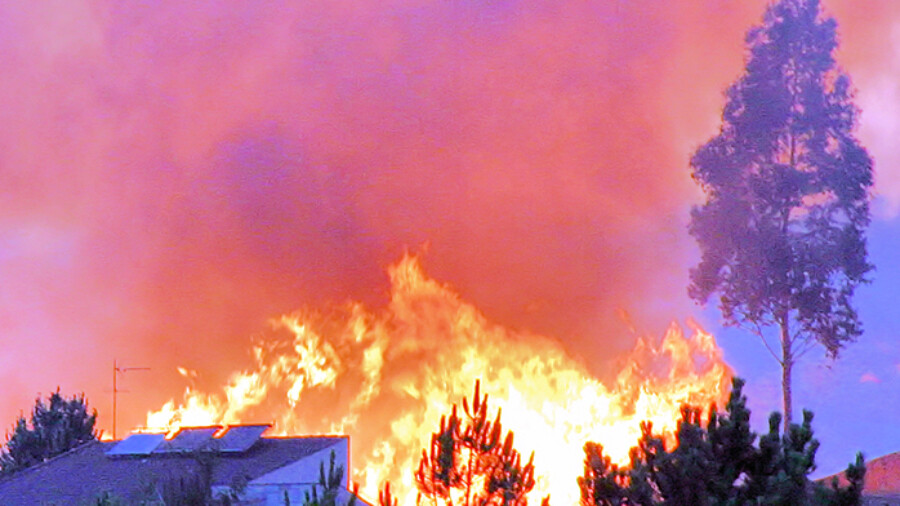 House fully engilfed in flames