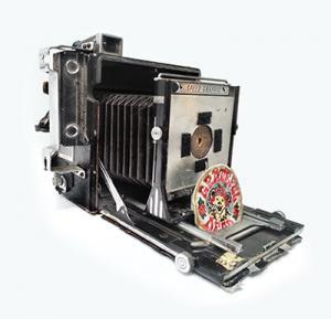"""Photographer Jody Akers converted this old Speedgraphic into a Pinhole camera. Note the Grateful Dead patch """"shutter""""."""